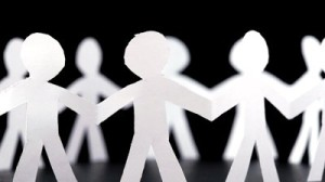 community creative collaboration paper people holding hands